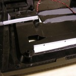 Here you see a square tube split into L-beams with holes drilled in them, which formed the hard drive mount.